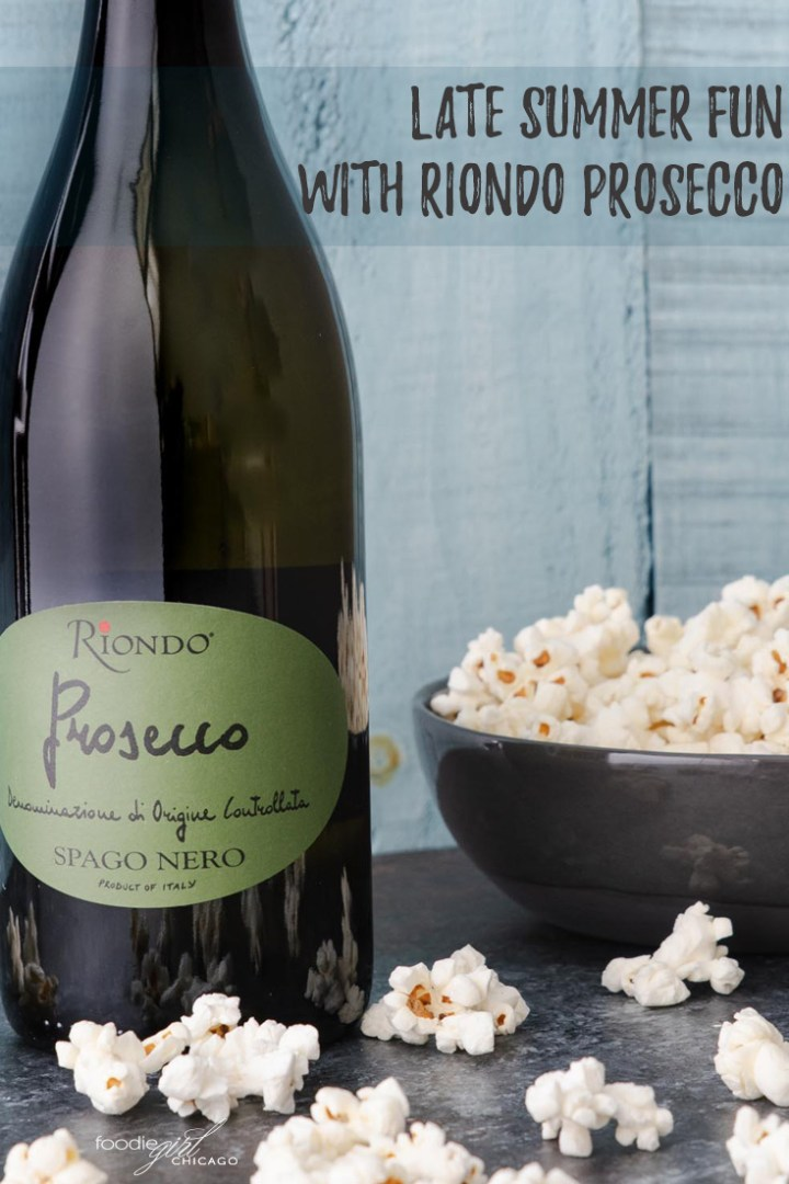 Riondo Prosecco bottle with popcorn bowl beside it