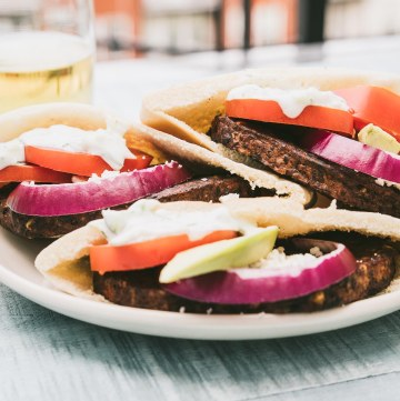 Veggie burgers with Greek-inspired toppings in a pita pocket