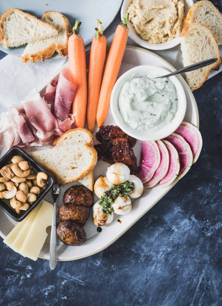 Snack dinner platter loaded with cheeses, meats and veggies