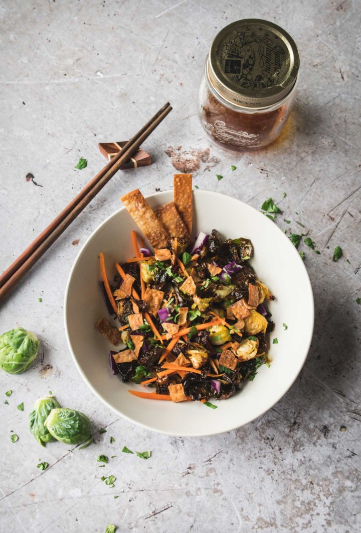 Crispy brussels sprouts topped with red cabbage, wontons and carrots