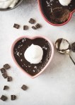 Espresso pot de creme in a pink heart dish topped with whipped cream