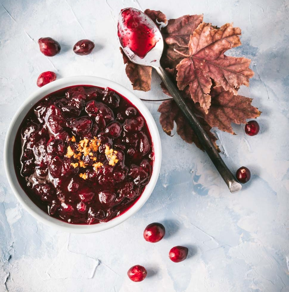 Homemade cranberry sauce in a light blue bowl shot from overhead