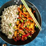 Pan with brown rice and stir fried cashew chicken shot from overhead