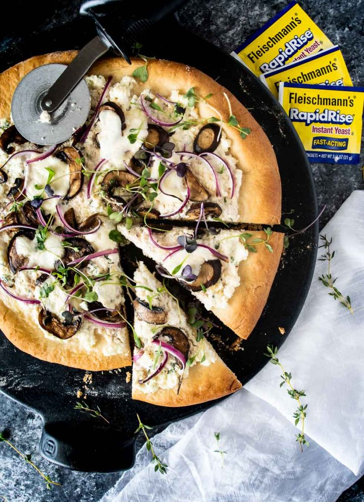 Ricotta mushroom pizza with two slices cut shot from overhead