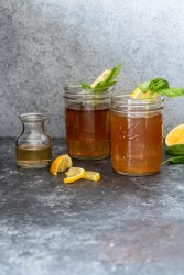 Two bourbon Arnold Palmers in Mason jars