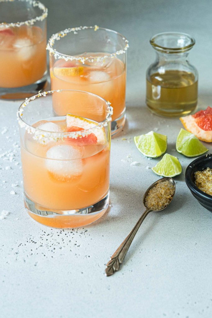 Three grapefruit margaritas with citrus salt and simple syrup