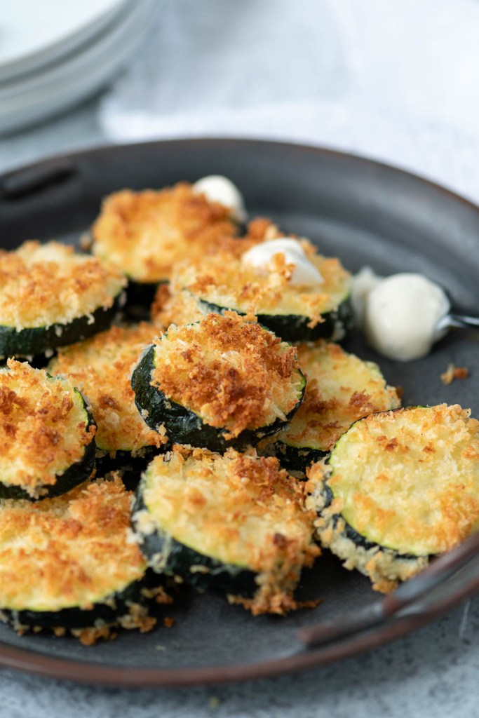 Close up of zucchini rounds breaded and air fried