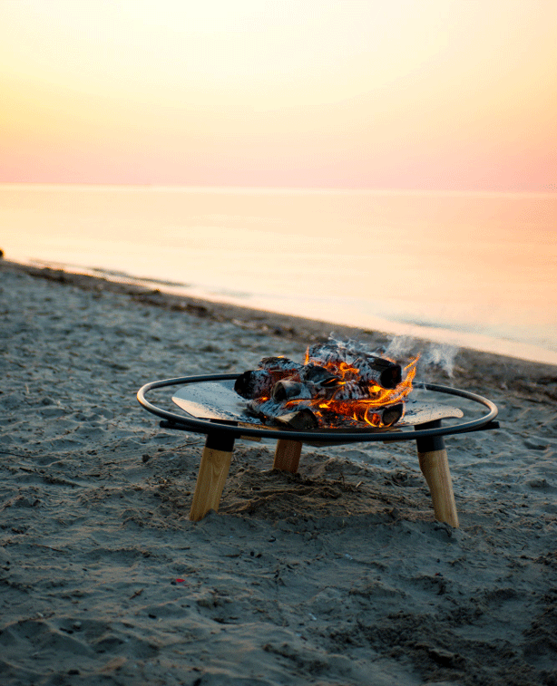 braent-firepit-on-sand-sunset
