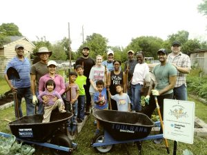 Volunteers Dig In For Adopt-A-Garden Kick-off