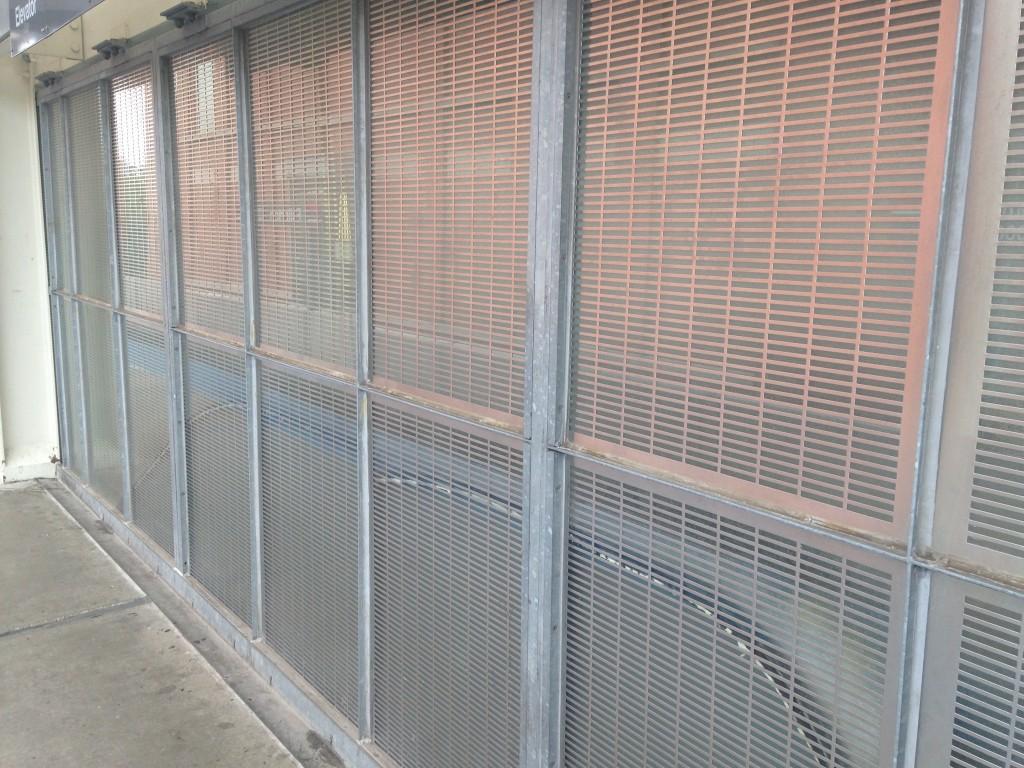 Galvanized metal railing at the CTA Fullerton station.