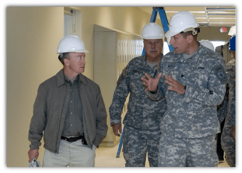 Mitch Daniels (left) visiting the Indiana National Guard (photo via Indiana National Guard Flickr)