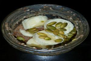 Chocolate Chia Pudding with Banana and Pumpkin Seeds