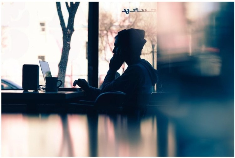 work from home laptop coffee mug disk coffee shop man