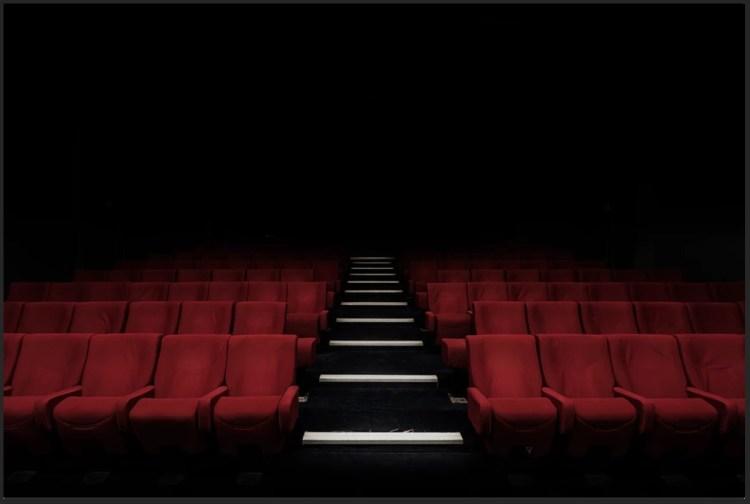 empty theater dark red seats steps