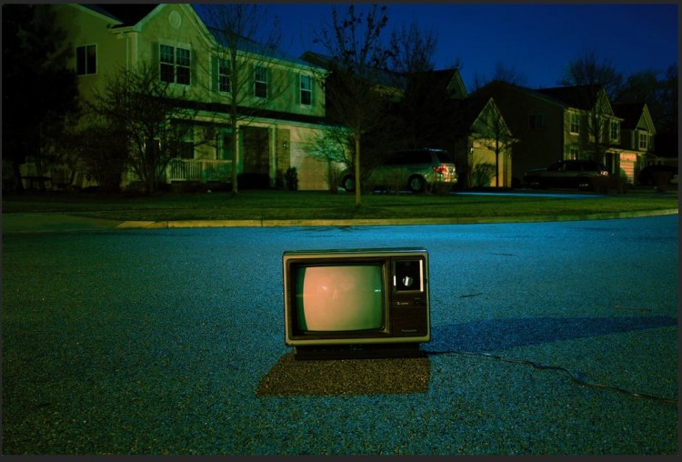 tube tv in middle of residential road