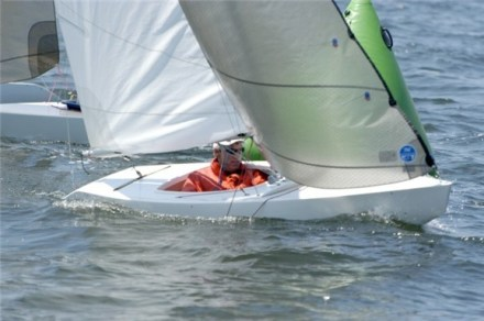 The 2.4 meter is 13 feet 8 inches long. Designed for competitive sailing, it is easily handled, trailered, launched and stored.