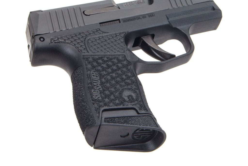 Grayguns laser-etched custom stipple. It's an $85 custom Sig P365 upgrade you will love!