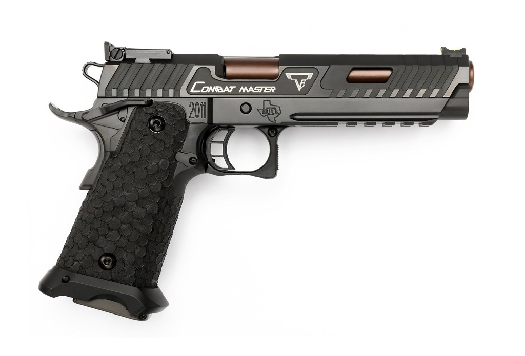 John Wick Combat Master 2011 from STI and TTI. This is an absolute beast of a handgun with a beast of a price tag. You want this gunporn, though, don't you?