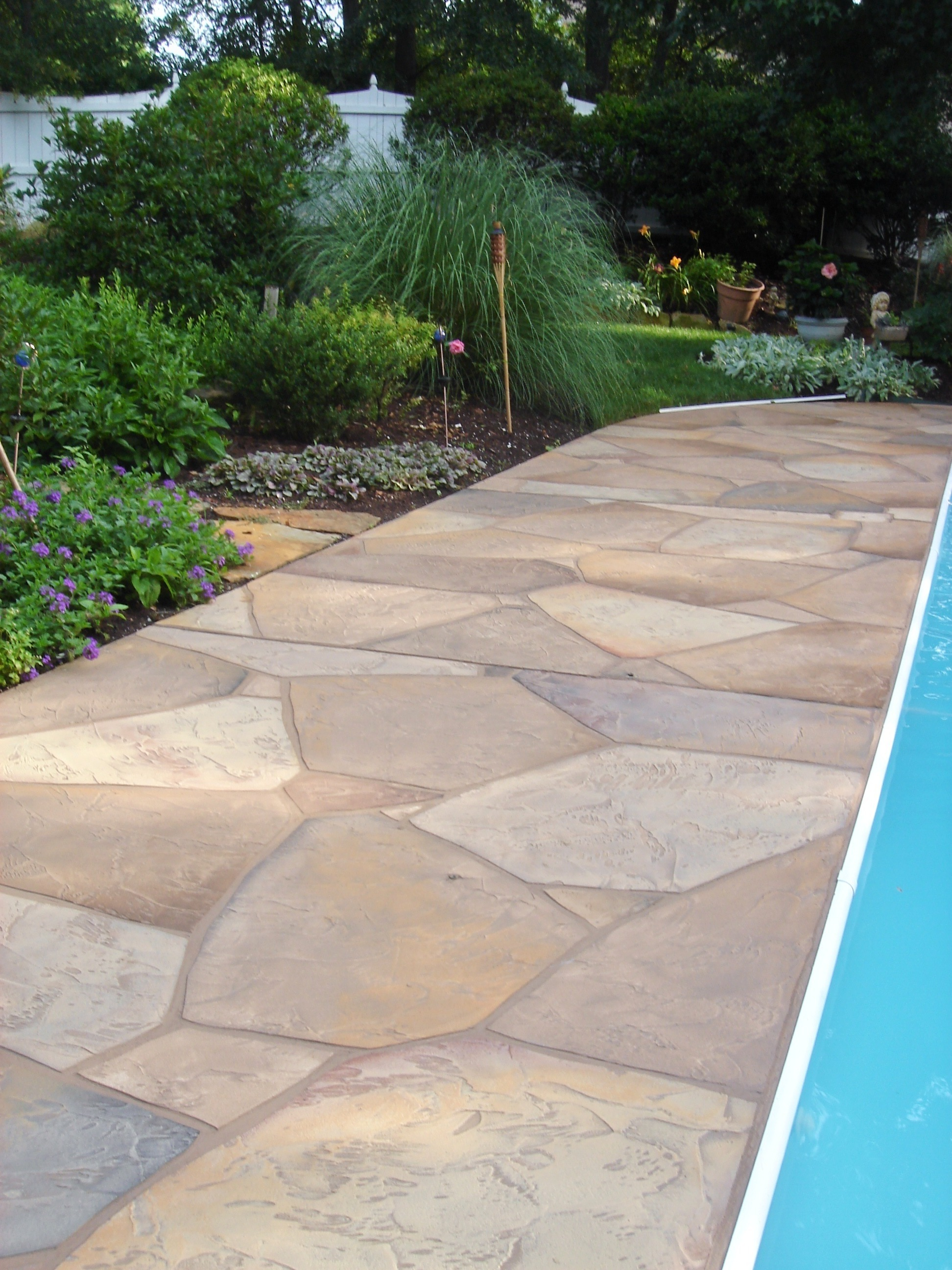 Flat Stone Patio Ideas · Stamped Concrete Pool Deck