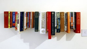 Books on hanging shelf.designblog