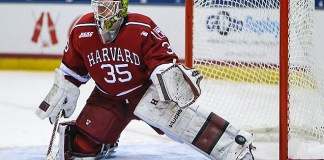 March 19, 2016: Harvard Crimson goalie Michael Lackey (35) takes shots during warmups prior to the 2016 ECAC Tournament Championship game between Harvard University and Quinnipiac University at Herb Brooks Arena in Lake Placid, NY. (John Crouch/J. Alexander Imaging)