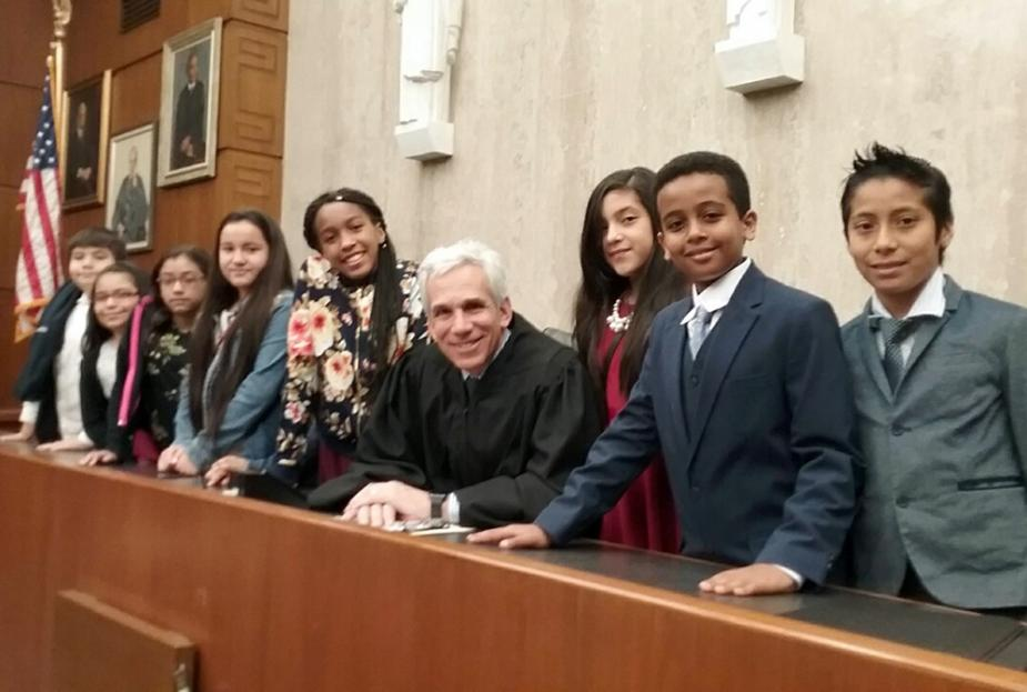 Students help at naturalization ceremony.