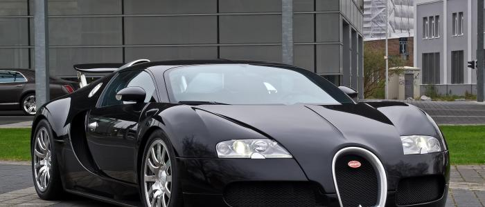 Why are the front grilles of Bugatti Veyrons made of titanium?