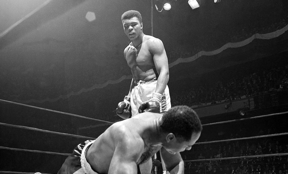 Zora Folley, left, moves in on champion Cassius Clay (Muhammad Ali) in first round of their heavyweight title fight in New York's Madison Square Garden March 22, 1967. (AP Photo).