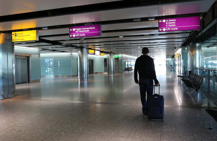 Photo of a an with suitcase at Heathrow Airport