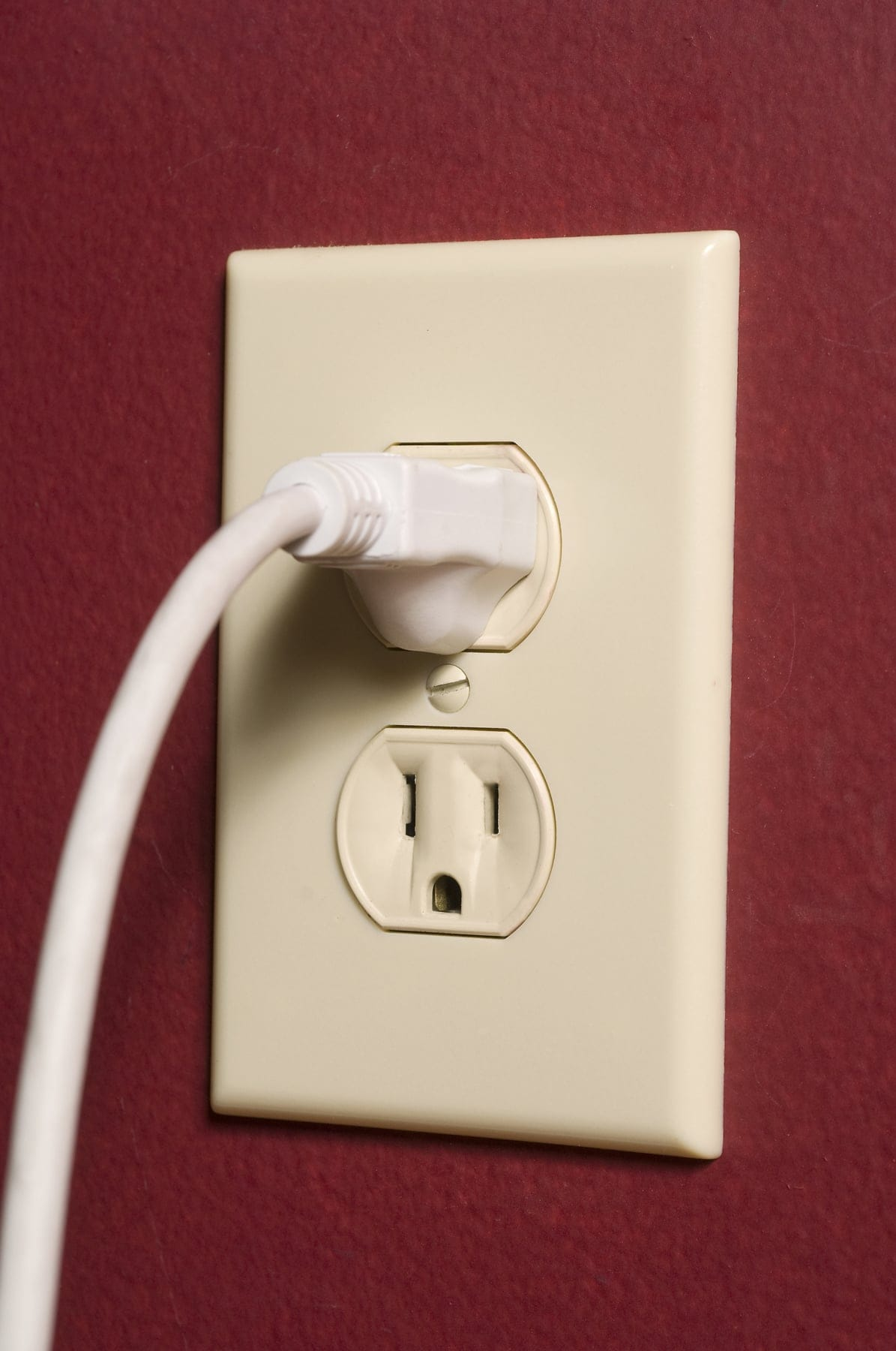 hight resolution of close up of outlet 3 prong cord fully inserted in top socket