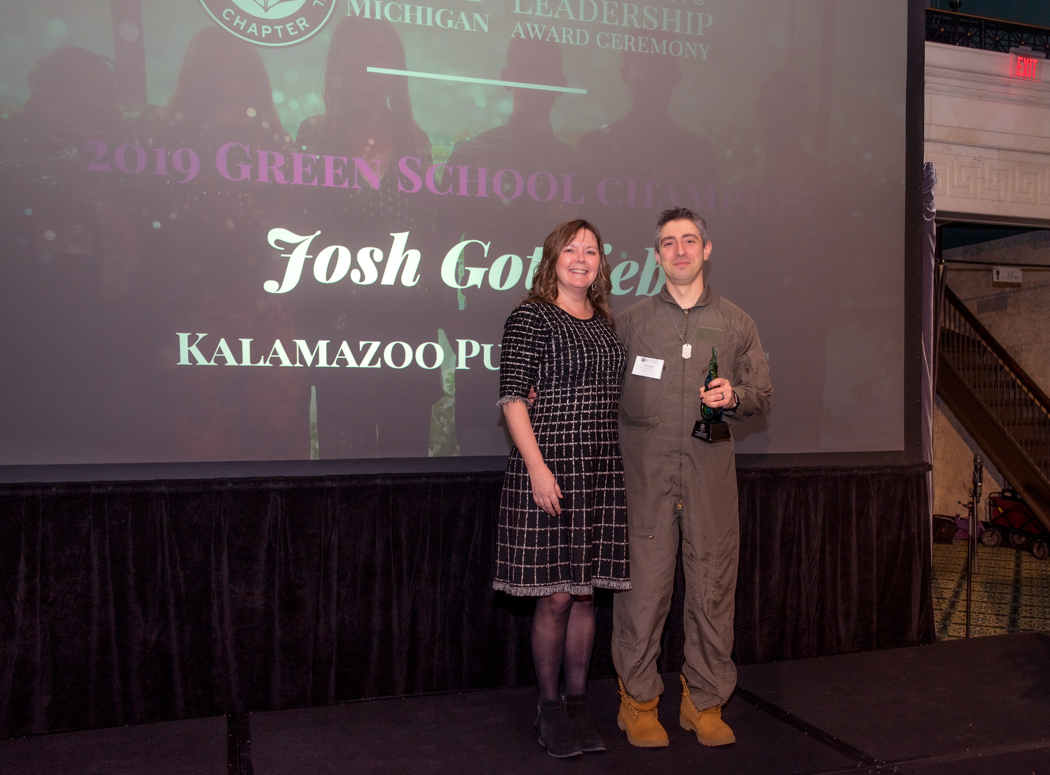 Josh Gottleib accepts award from Cheri Holman at 2019 Leadership Award Ceremony.