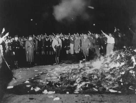 """Books and writings deemed """"un-German"""" are burned at the Opernplatz. Berlin, Germany, May 10, 1933."""