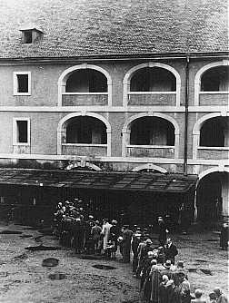 Prisoners wait for food rations. Theresienstadt ghetto, Czechoslovakia, between 1941 and 1945.