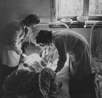 Soon after liberation, a camp survivor receives medical care. Bergen-Belsen, Germany, after April 15, 1945.