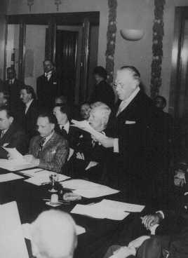 Myron Taylor, US delegate to the Evian Conference, pleads for the establishment of an intergovernmental committee to facilitate Jewish emigration. Evian-les-Bains, France, July 15, 1938.