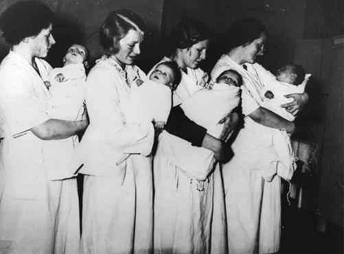 32285ec87a9e Mothers who have given birth in a National Socialist maternity home wait to  have their babies