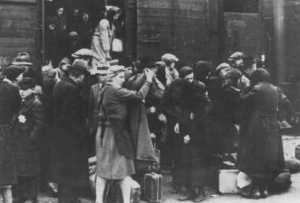 A transport of Jews from Hungary arrives at Auschwitz-Birkenau. Poland, May 1944.