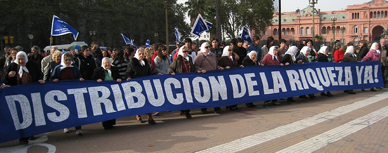 Women march in a protest by the Mothers of the Plaza de Mayo, more than 30 years after the group led a campaign that helped topple Argentina's military regime.