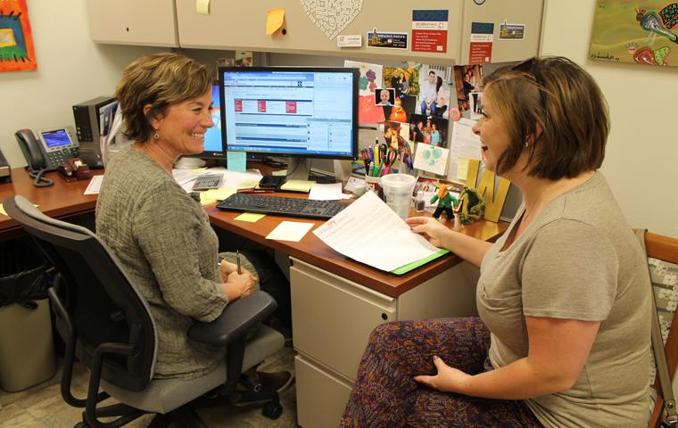 Freshman nursing major Megan Peninger discusses her upcoming fall schedule with Academic Adviser Connie Walker in the College og Nursing and Health Professions Advising center Monday. Photo by Hannah Spurgeon/The Shield