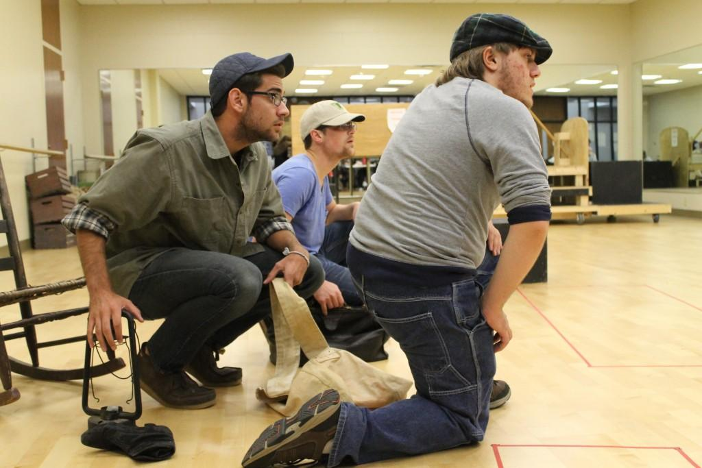 "Freshman theatre arts major Conner Keef, playing as Tom Joad, hides out with sophomore theatre arts major Cameron Ward, playing as Jim Casy, and freshman theatre arts major Aaron Newton as they rehearse a scene in the ""Grapes of Wrath"" which runs Oct. 15-18 in the Performance Center."