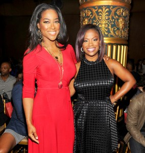 Kenya Moore and Kandi Burruss attend the Kithe Brewster fashion show during Mercedes-Benz Fashion Week Spring 2015 in New York City.