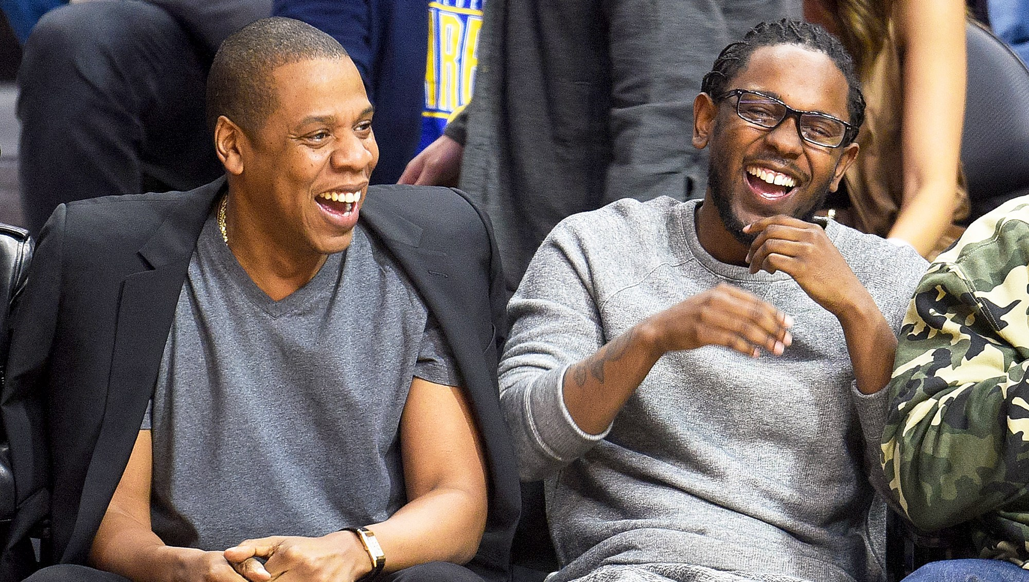 Jay Z and Kendrick Lamar attend a basketball game between the Golden State Warriors and the Los Angeles Clippers at Staples Center on February 20, 2016 in Los Angeles, California.