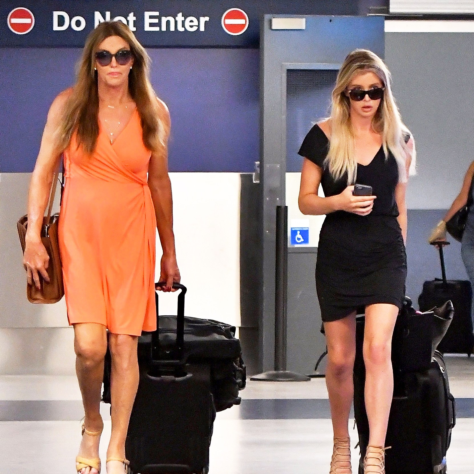 Caitlyn Jenner and Sophia Hutchins seen arriving on a flight at LAX airport in Los Angeles, California.