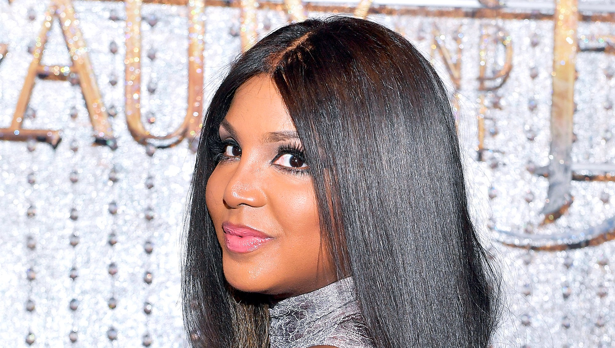 "Toni Braxton arrives at the world premiere of Disney's new live-action ""Beauty and the Beast"" photographed in front of the Swarovski crystal wall at the El Capitan Theatre in Hollywood, California."