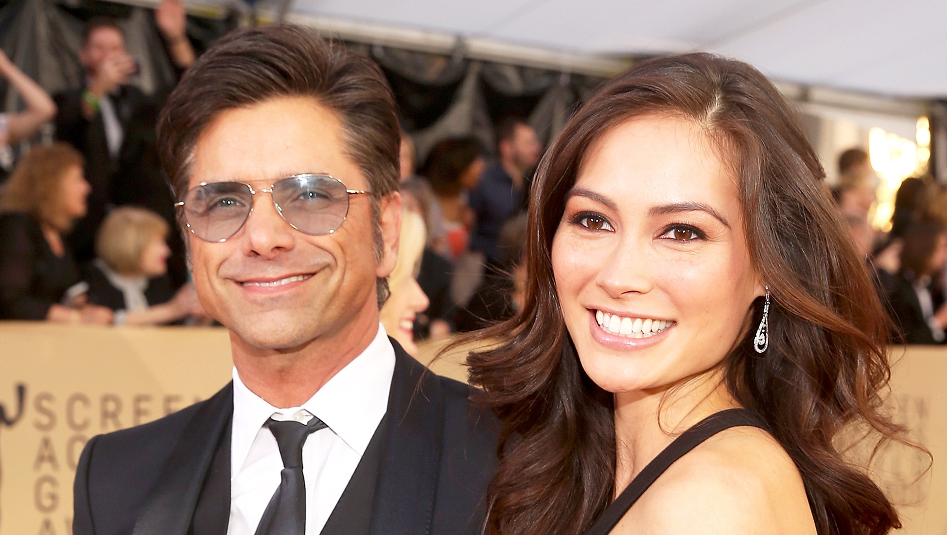 John Stamos and Caitlin McHugh attend the 24th Annual Screen Actors Guild Awards at The Shrine Auditorium in Los Angeles, California.