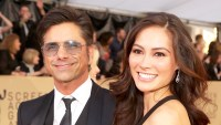 John Stamos and Caitlin McHugh attend the 24th Annual Screen ActorsGuild Awards at The Shrine Auditorium in Los Angeles, California.