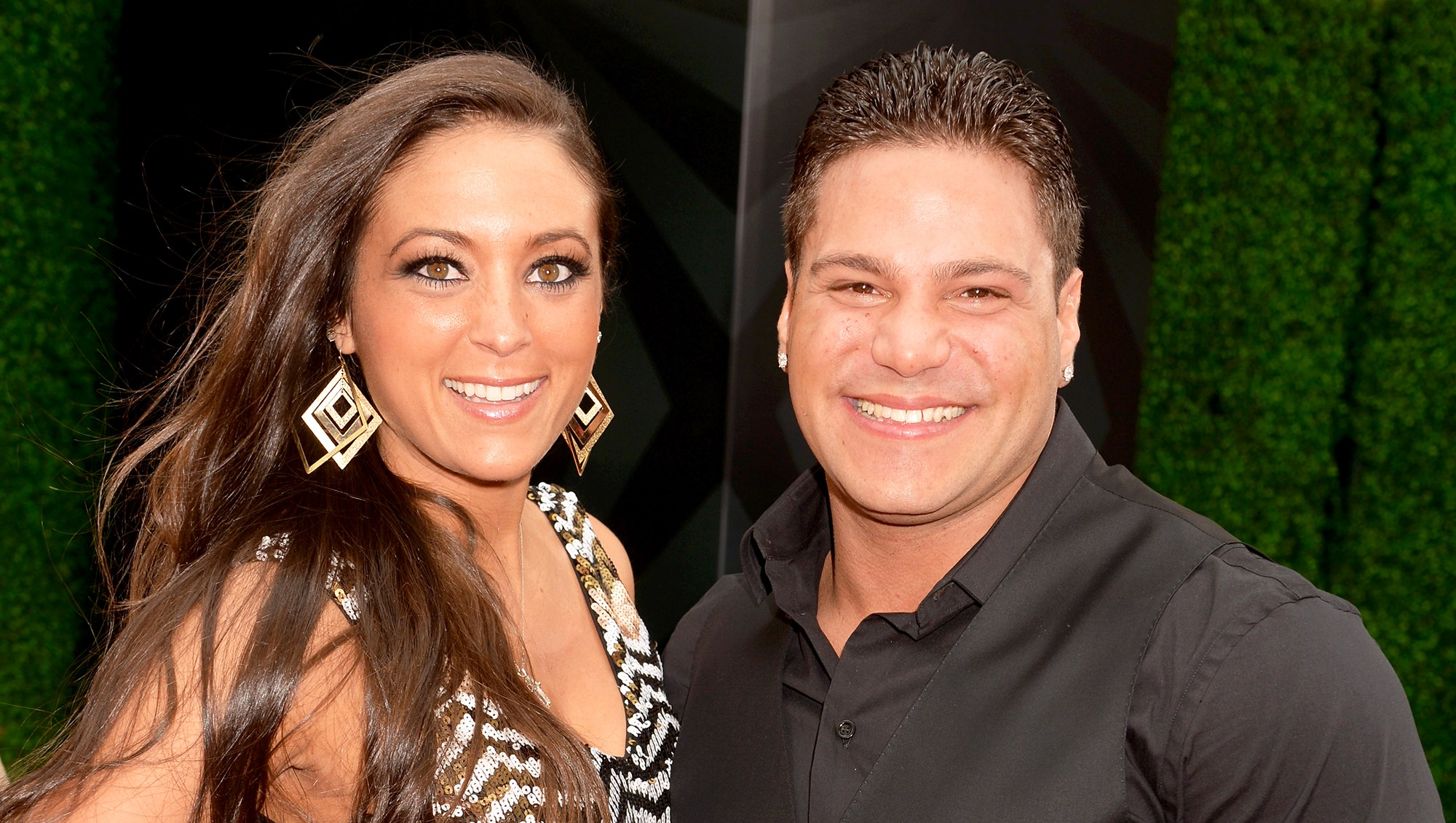 Sammi Sweetheart Giancola and Ronnie Ortiz Magro attend the 2013 MTV Movie Awards at Sony Pictures Studios in Culver City, California.