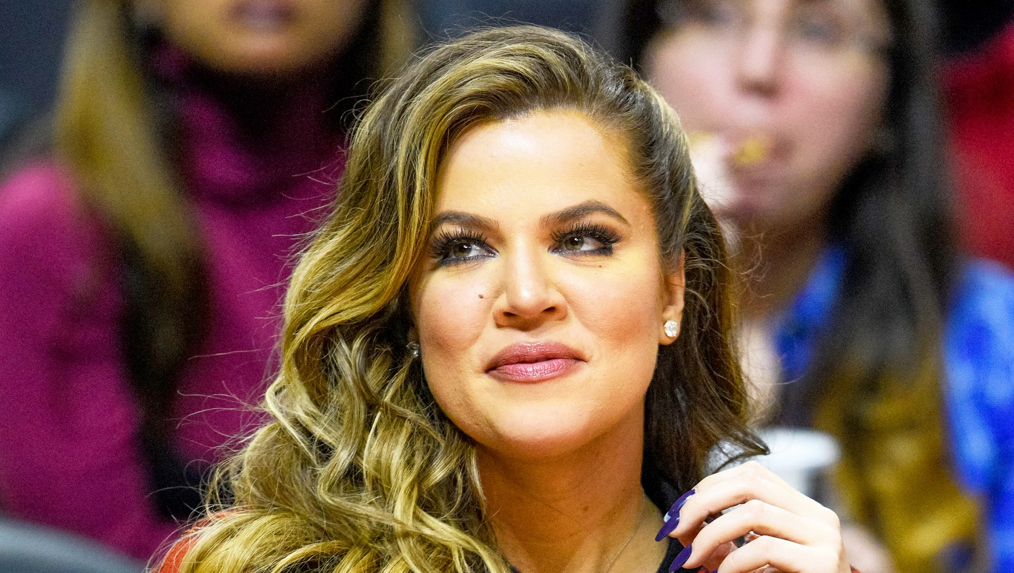 Khloe Kardashian attends a 2014 basketball game between the Detroit Pistons and the Los Angeles Clippers at Staples Center in Los Angeles, California.