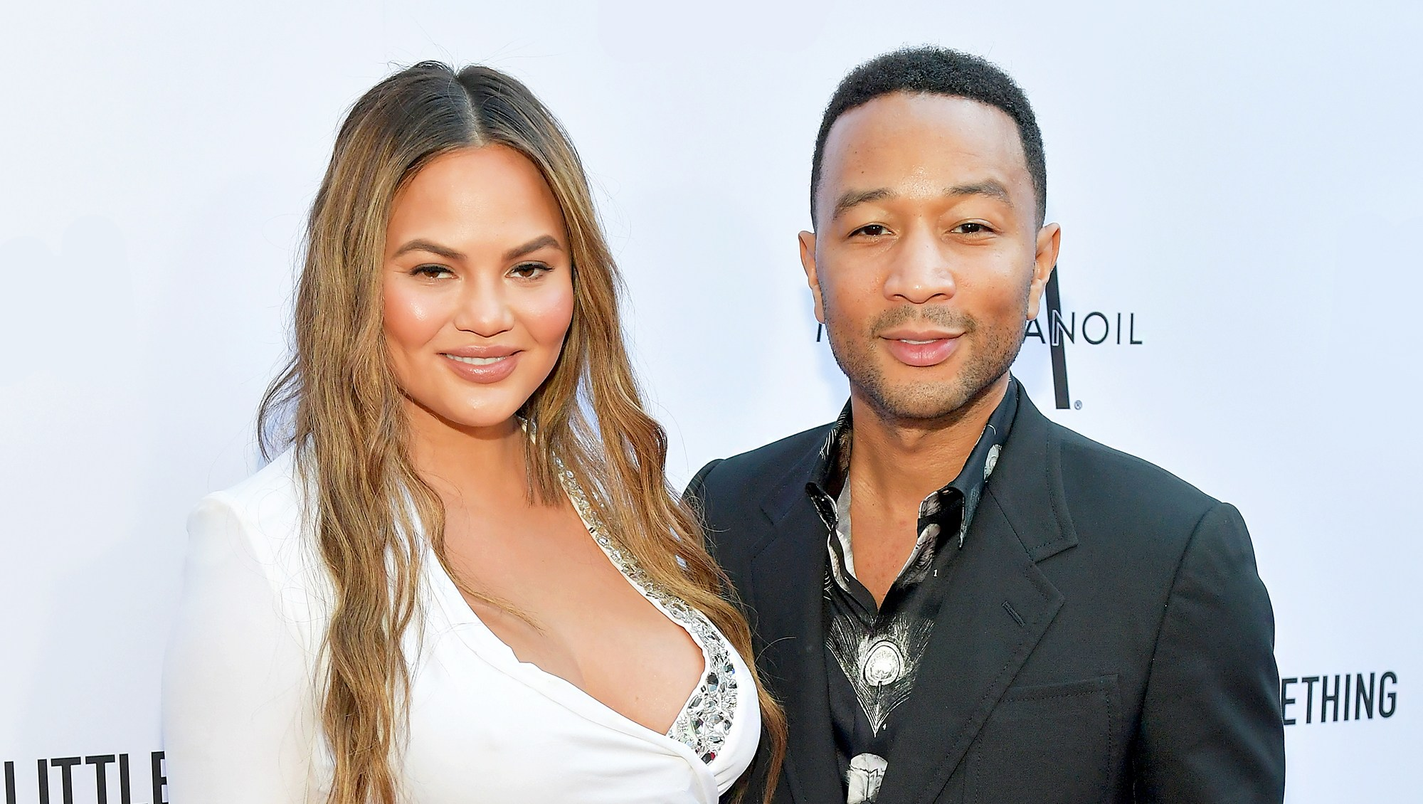 Chrissy Teigen and John Legend attend The Daily Front Row's 4th Annual Fashion Los Angeles Awards at Beverly Hills Hotel on April 8, 2018 in Beverly Hills, California.