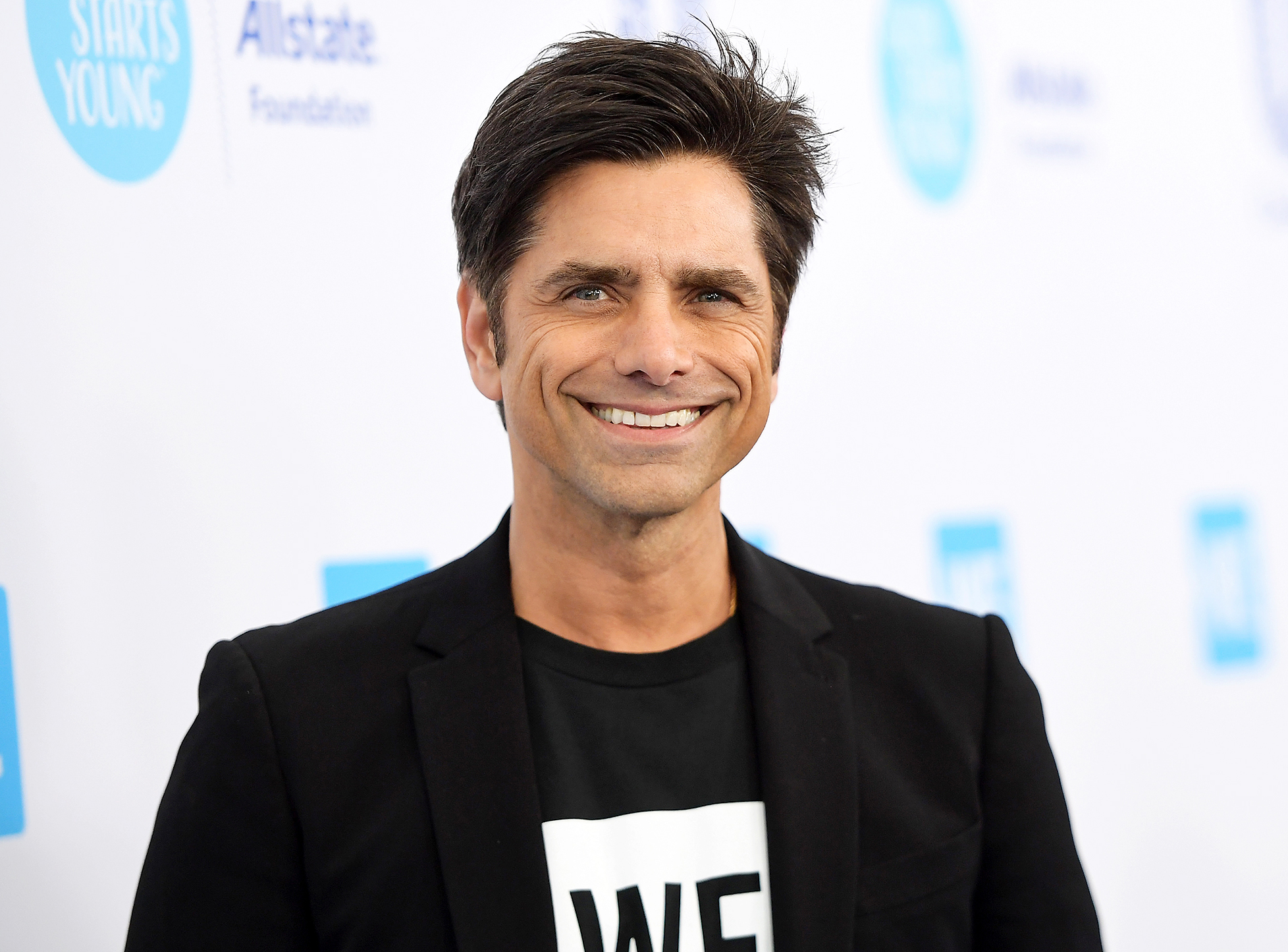 John Stamos breaks down in first interview as a father